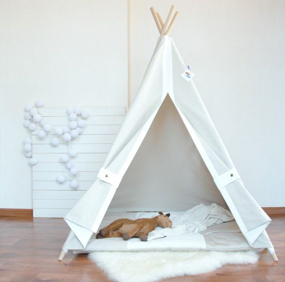 This light beige canvas teepee is made of 100% cotton. Cuffs white color. Holders with stainless steel buttons. To the right of the entrance - a window with a curtain. Teepee is formed as an umbrella for a few seconds. It can be used indoors or outdoors, but do not leave it in the rain. ALL OUR TEEPEES WITH POLES AND BAG FOR STORING TEEPEE.  The mat is made of 100% cotton fabric. The colors of the mat white and light beige. The mat is filled with synthetic padding.  You can order only a…