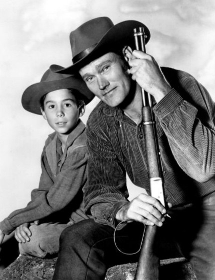 The Rifleman aired on ABC from September 30, 1958 to April 8, 1963.  Chuck Connors as rancher Lucas McCain and Johnny Crawford as his son, Mark McCain. It was set in the 1880s in the town of North Fork, New Mexico Territory.