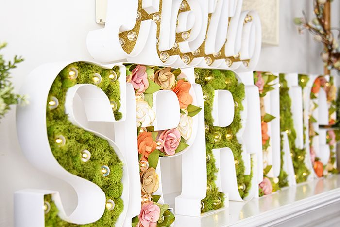 Spring mantle with Heidi Swapp marquee letters and flowers from Michael's craft store.