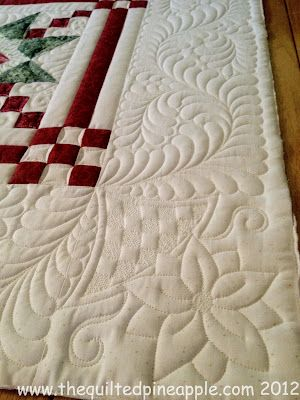 What's a Christmas quilt without a few poinsettias??  And feathers.  Cannot forget the feathers!