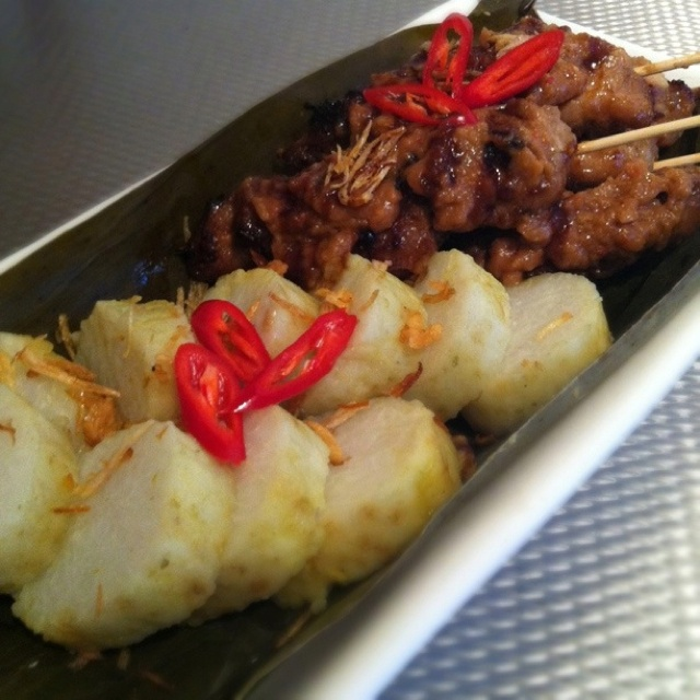 Sate with lontong