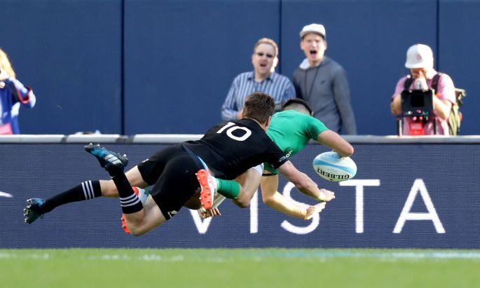 Ireland's Conor Murray scores their third try despite Beauden Barrett of New Zealand. Photo: Billy Stickland/Inpho