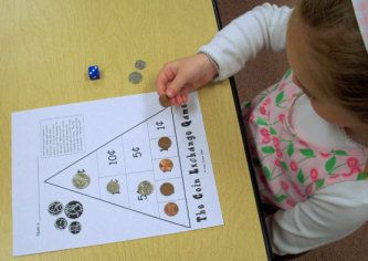 Coin Exchange Game - roll die and put that many pennies on board - when have 5 pennies, trade them in for nickel, work way up to quarter