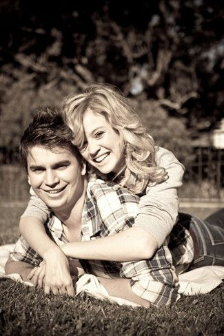 Engagement Photo Poses and Ideas - looking happy lying on the grass together