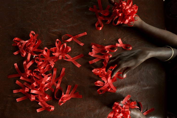 Nov. 30, 2012. HIV positive women make red ribbons, the universal symbol of awareness and support for those living with HIV, at a support center in Bangalore.