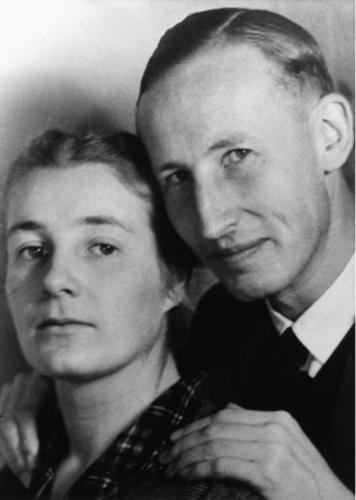 Reinhardt & Lina Heydrich. About as loathsome a couple as anyone could meet. A fervent Nazi, she convinced him to try a job with the SS, where he rose to become architect of the Final Solution before Czech Resistance fighters killed him in Prague, 1942. He was never faithful to her, spending hours in brothels until he finally est'd one that'd enable him to spy and hold blackmail material on high-ranking Nazis and political leaders.