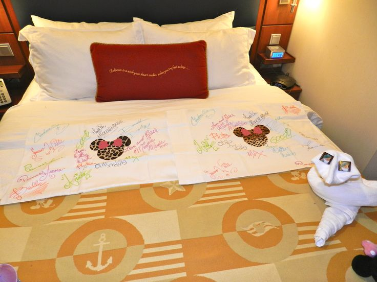 Cruise Tip  Bring plain pillow cases and put them in a zip lock with sharpies and your cabin number.  They will be brought to your stateroom will all the characters signatures!!  I added the Minnie Mouse iron on in the middle.