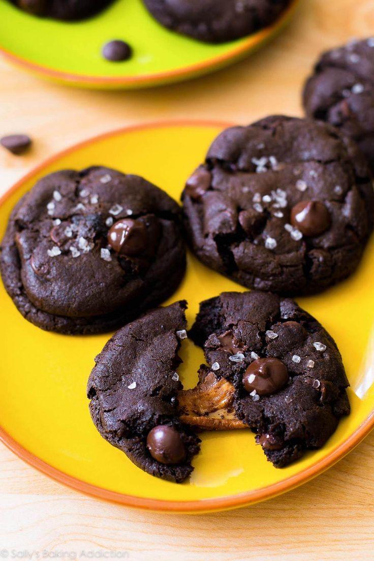 Decadent dark chocolate cookies stuffed with caramel and topped with sea salt. Totally worth every bite! Recipe on sallysbakingaddiction.com