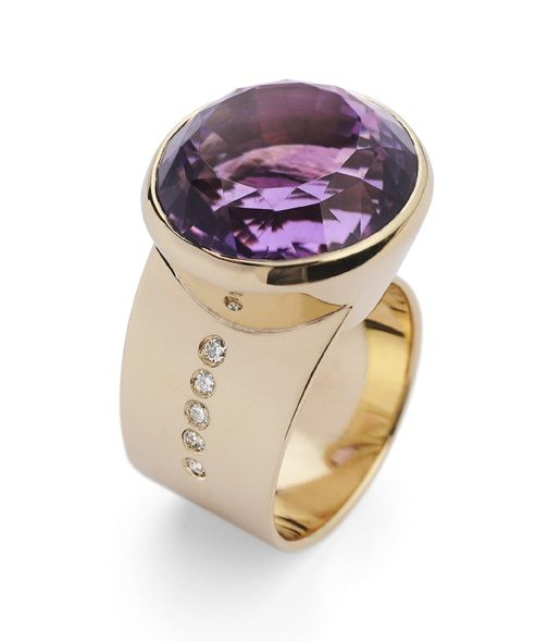 David Fowkes Jewellery. Amethyst ring in 18 carat yellow gold with a run of diamonds.