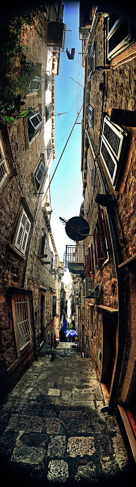 Croatia - Dubrovnik  --This is a clever way of turning the traditional panoramic picture on its head to display the narrow space between buildings.