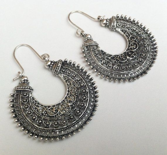 An exquisite... Pair of Tribal Earrings All items in my shop are designed and handcrafted by me. These gorgeous earrings are wonderful hanging half