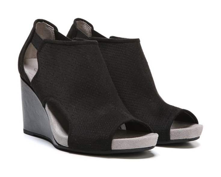 Look and feel like a VIP in the of-the-moment Hinx wedge bootie from LifeStride. Faux leather upper with a peep toe, covered silhouette, side cutouts, perforated accents, cupped heel, and elastic goring straps for extra flexibility.Soft System® comfort package provides all-day support, flex, and cushioningTraction sole provides you with extra stabilityJust Right Height 3 inch cork-wrapped wedge heel