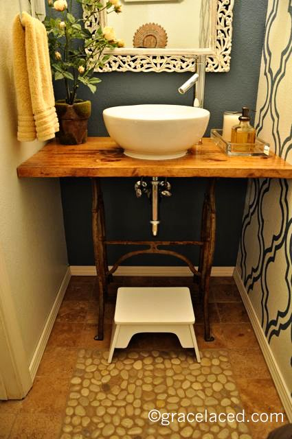 Vanity made from an old sewing table!! :) I do like those bowl sinks. And I LOVE the floor! It's a pebble faux bath mat. <3