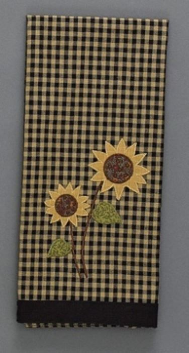 From the Sunflower Check Collection by Park Designs Decorative Dishtowel Black and Tan small Check Check size is 3/8 in Features an Applique Sunflower and has a solid black border that measures 1.25 in 100% Cotton - Imported Reverse side is solid black Measures 18x28 in MPN: 379-19 UPC: 762242358447