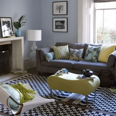 #den charcoal couch with pops of colour