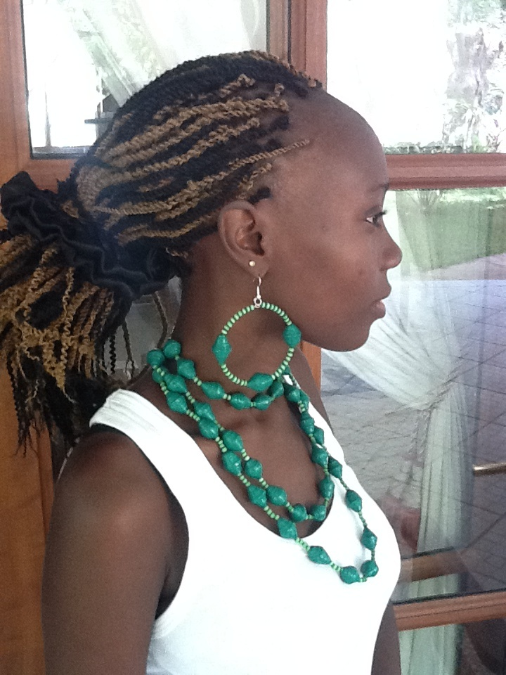its made from paper beads its tripple necklace with  its round earings