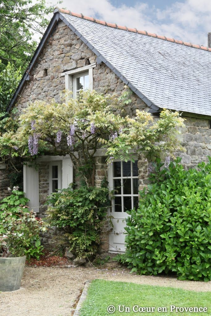Le Mesnil Des Bois. Modify this look into Potting Shed.  Gravel path,container plants,wisteria growing up almost like an awning. Window above would allow more natural light, maybe attach a small green house.