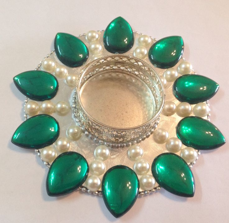 Fancy Kundans n pearls Tlight holders :)https://www.facebook.com/akarshanbangalore/