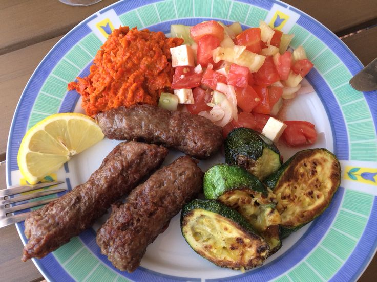 Our dinner made in Croatia ;)  Cevapcici with aivar - domestic speciality served with such meat, salad and grilled courgette - was delicious!!!