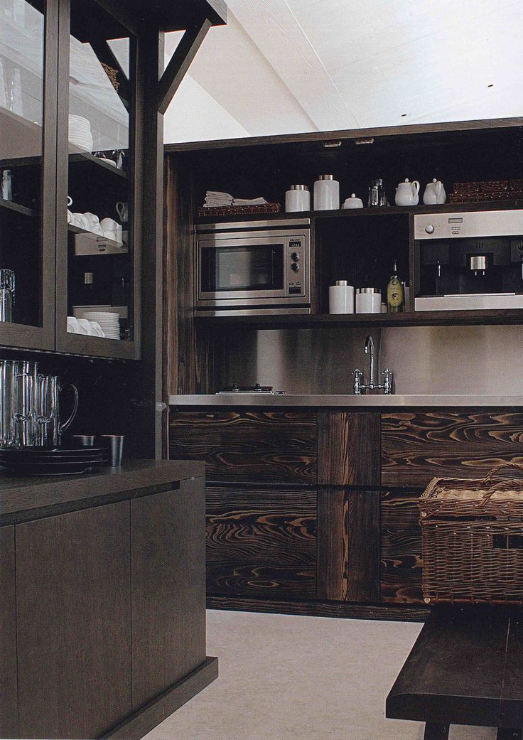 Combine wood with steel for a dynamic and modern kitchen // Kitchens: Wood Cabinets, Dark Shelves, Paintings Kitchens Cabinets, Wood Kitchens, Modern Rustic, Interiors Houses, Christian Liaigr Interiors, Cabinets Ideas, Modern Kitchens