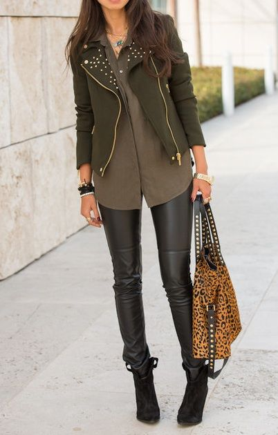 olive green studded jacket over grey tank, w/ black skinnies.