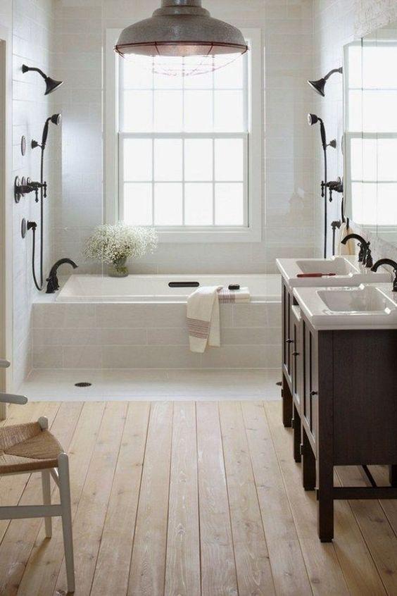 Light Filled Farmhouse Bathroom With A Wooden Floor In 2020 Farm Style Bathrooms Farmhouse Bathroom Decor Modern Farmhouse Bathroom