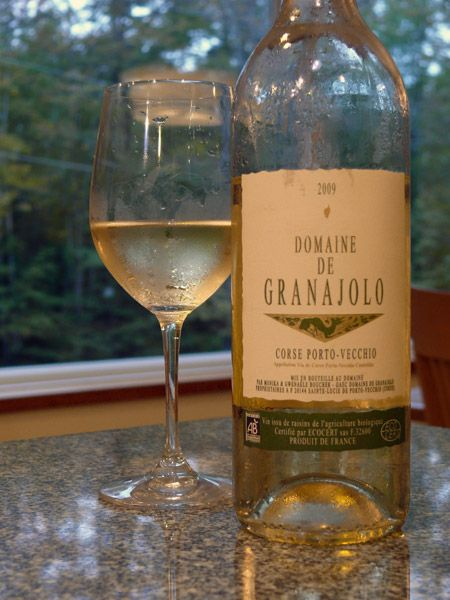 Domaine de Granajolo  Corse Porto-Vecchio  2009  13% ABV   Price: about $14    André Boucher's Domaine de Granjolo comprises20 hectares in the southern tip of Corsica. The granitic soils are farmed organically, and Boucher's daughter Gwenaele is the winemaker. This wine is 100% vermentinu (vermentino).    Spritely aromas of bay leaf, sage, lemon, and citrus blossom rise to meet you. The wine has a smooth texture and succulent flavors of citrus and wild herbs, with a cleansing bitter cut.