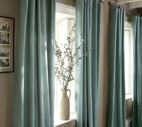 neutral wall with colored drapes