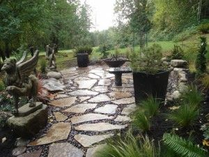 Flagstone And River Rock Patio