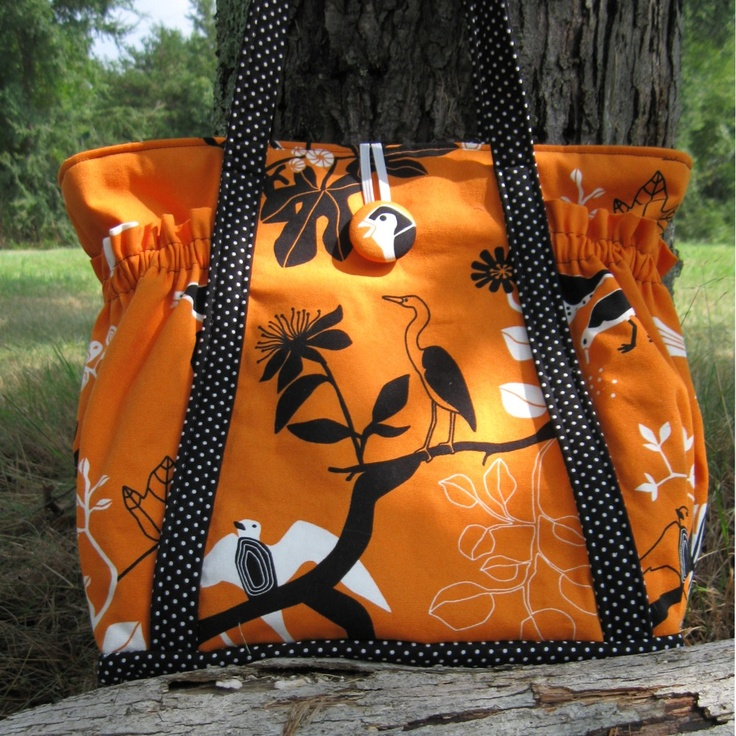 Orange, black and polka dots - can't go wrong.  Obviously a cute bag - but makes for a stylish diaper bag/kids stuff tote too!