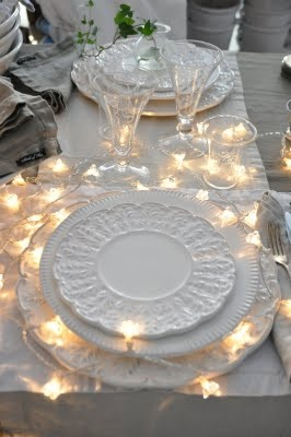 Pretty white dishes. So many options for holiday tablescapes...Love the lights. #christmas #tablesetting