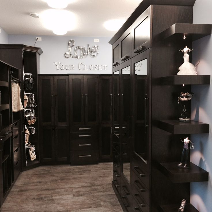 Dark Stained Maple Closet Display in our Showroom with Lazy Shoezen, Floating Shelves with LED Lights and Mirrored Armoire