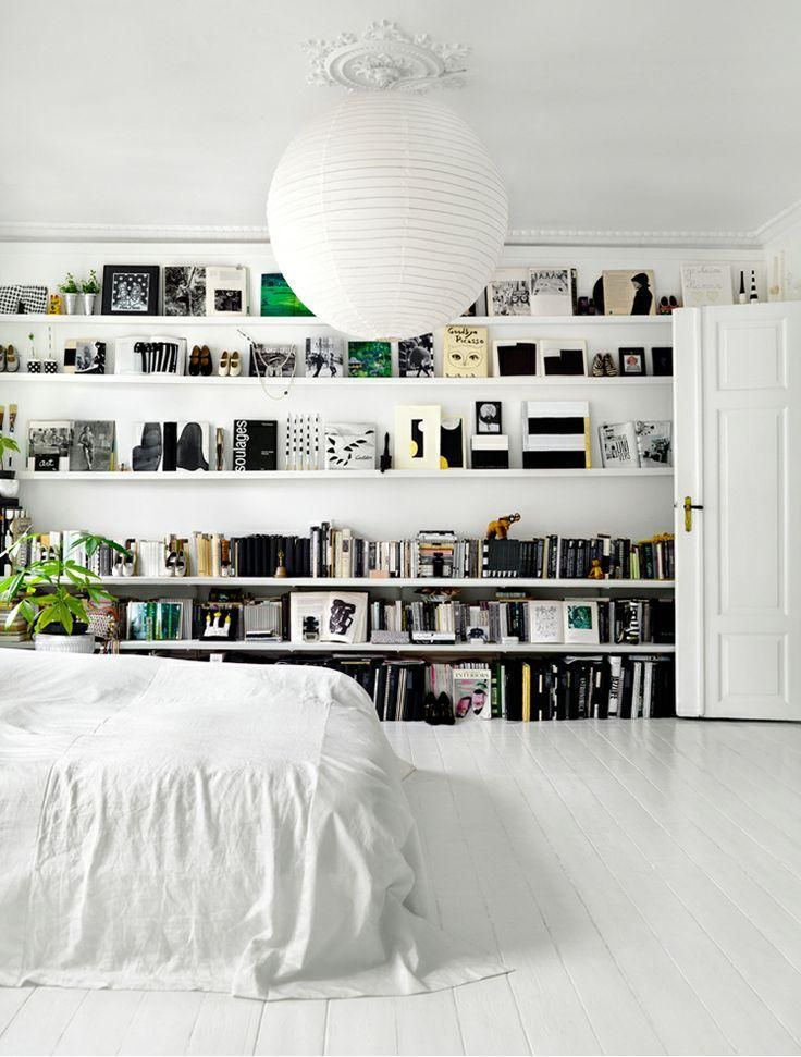 bookshelves in the bedroom like how it's a floor to ceiling bookshelf