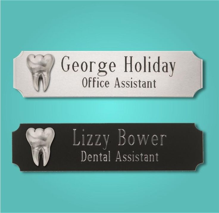 """Silver Tooth Logo Namebadges Item DY168, Dy169 Make a professional statement with our contemporary namebadge featuring easy-to-read engraving and attractive design. Choose from Black Aluminum or Brushed Aluminum.  Name tag arrives boxed with both a pin back and magnetic back.  Approximately 3/4"""" x 3""""."""