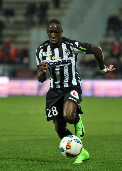 Angers' Senegalese defender Issa Cissokho runs for the ball during the French L1 football match between Angers (SCO) and Rennes, at the Jean Bouin Stadium, in Angers, northwestern France, on February 8, 2017.  / AFP / GUILLAUME SOUVANT