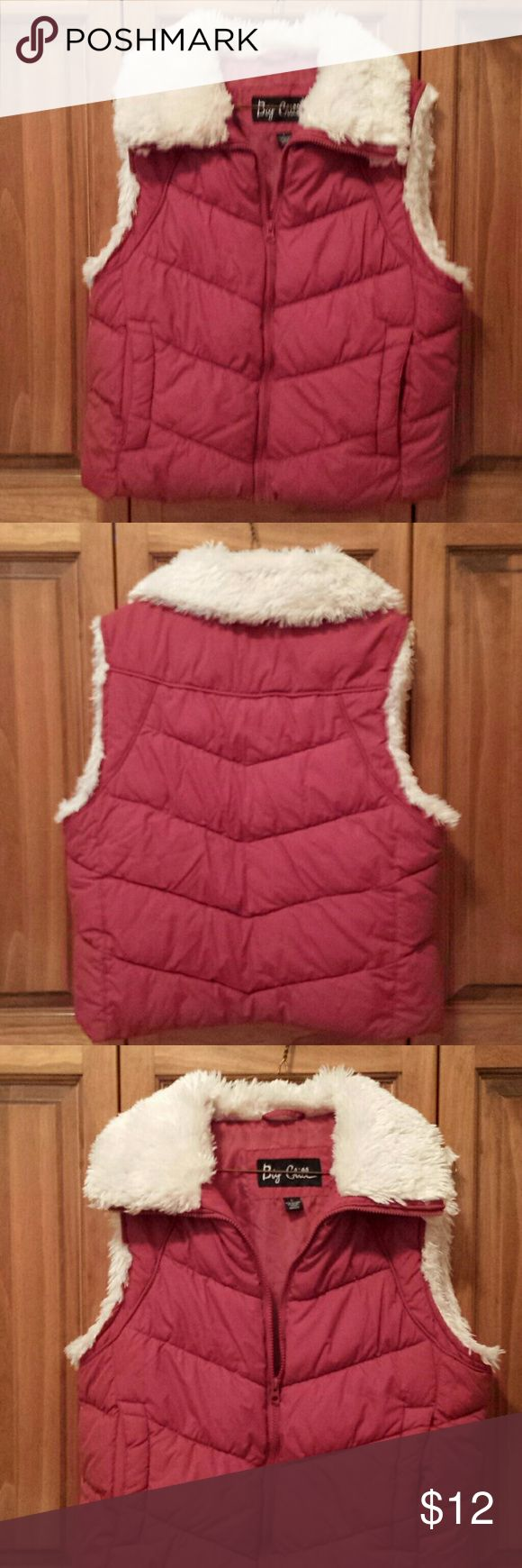 Womens Puffer Vest Good used condition.  Gently worn puffer Vest in a deep burnt orange color . Fur collar and sleeve edges are trimmed in a cream color. Zip up front with 2 pockets. Big Chill Jackets & Coats Puffers