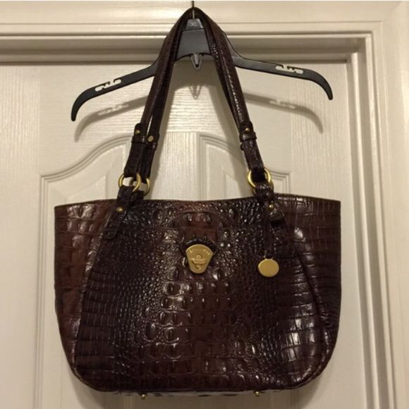 Brahmin handbag Really good condition outside of this brown croc Brahmin handbag!!! The interior as shown in the last picture has a lot of pen marks so price reflects that. Gorgeous outside though!!! Brahmin Bags Shoulder Bags
