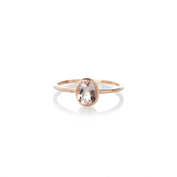 A 9ct rose gold brilliant cut 0.90ct oval morganite in a bezel setting (approximately 5mm x 7 mm in size).  When ordering one of our gold stone rings please provide us with your exact ring size. This can be done in the comment box once your order has been placed.   To find out more about our ring sizes please visit our sizing page in the footer below.