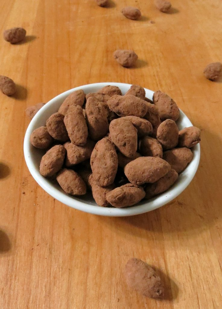 Chocolate Covered Almonds - Roasted almonds covered in milk chocolate and coated with cocoa powder.