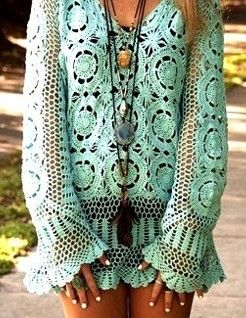 Boho chic crocheted modern hippie blouse bathing suit beach cover up with gypsy style layered necklaces.