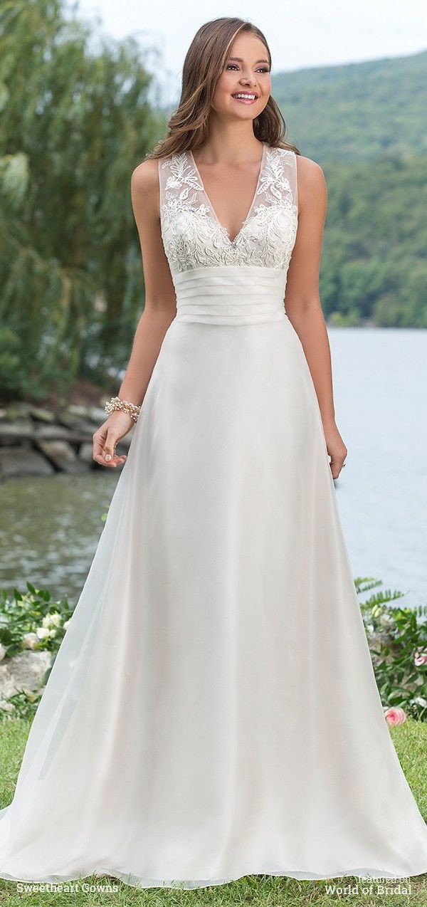 Look charming at any outdoor venue in this slim A-line charmeuse and organza gown with a V-neckline, corded lace bodice, illusion back, natural waistline, and sweep train.