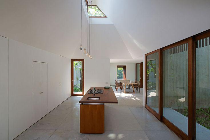 Kitchen House on a Stream #whitespaces #openkitchen #kitchenisland #slidingwindows #weekendhome #architecture #contemporary #indianarchitecture