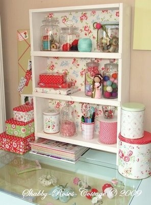 I need to line some of my bookshelf backs with fabric - this is too cute!! I like the jar collections, too.