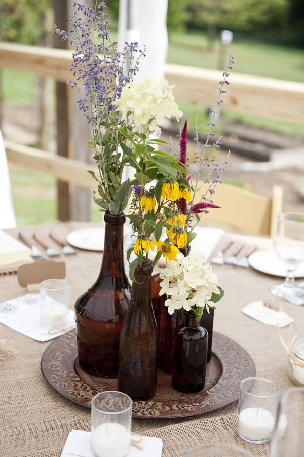 brown bottle centerpieces- not the right colors, but what about a charger to break up the colors?