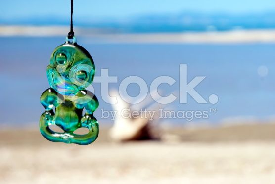 Typical Maori Tiki with Sea Background royalty-free stock photo