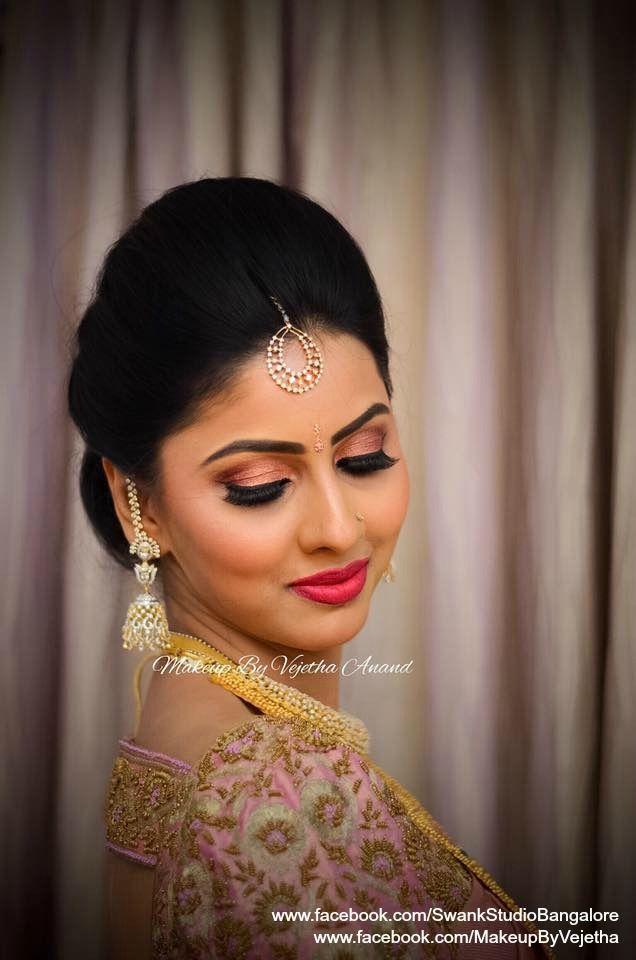 Aparna looks gorgeous for her engagement. Makeup and hairstyle by Vejetha for Swank Studio. Red Lips. Diamond jhumkis. Eye makeup. Bridal jewelry. Bridal hair. Silk sari. Bridal Saree Blouse Design. Indian Bridal Makeup. Indian Bride. Gold Jewellery. Statement Blouse. Tamil bride. Telugu bride. Kannada bride. Hindu bride. Malayalee bride. Find us at https://www.facebook.com/SwankStudioBangalore