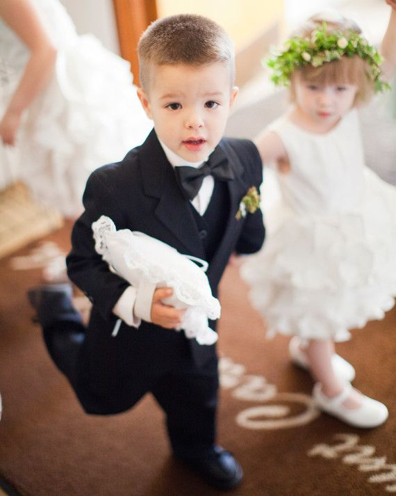 Dressing your flower girl can be so much fun—those tiny dresses,flower crowns, and girly accessories! But you can't forget about the little guy carrying your precious cargo down the aisle. There are so many ways to dress your ring bearer for the occassion, from unique ring pillows and cool hairstyles to mini bow-ties, suspenders, fedoras, and so much more! Get inspired by these adorably dapper ring bearers from real weddings.    Ring Bearer Pillow with Meaning  This c...