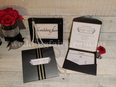 A retro styled pocket invitation with 2 staggered inserts included.  This Invite is finished with a touch of gold.  The pocket is sealed with black and gold satin ribbon and art deco style tag.  Available in a selection of 12 colours.