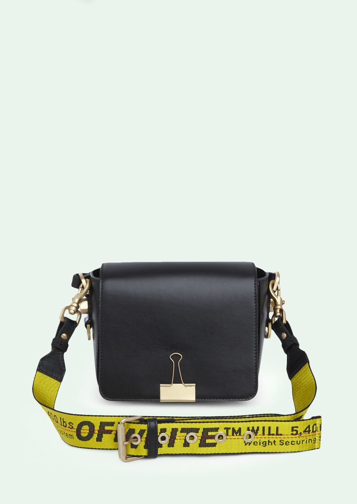 """Off-White c/o Virgil Abloh introduces The Binder clip Bag, a modern interpretation of an uncalculated leather cross body satchel finisched with sophisticated detailing and an additional """"TIE DOWN"""" Industrial belt strap. Modern yet timeless, combines ease"""