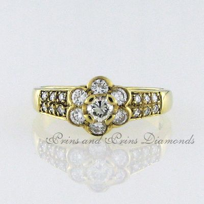There are 19 = 0.62ct round brilliant cut diamonds tube and pavé set in 18k yellow gold